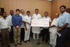 MINISTER NARAYANRAO RANE PRESENTED A CHEQUE OF Rs.1 CRORE TO CHIEF MINISTER RELIFE FUND AT VIDHAN BHAVAN.