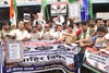 Mumbai Congress SC/ST Cell Protest outside Dadar Station on issue of IMen Burning  a copy of the India's Constitution at Parliament Street in Delhi.